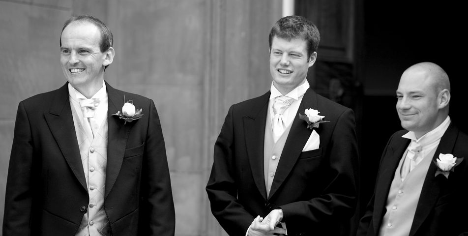The groom and ushers wait outside for the arrival of the bride at Tatton Hall cheshire