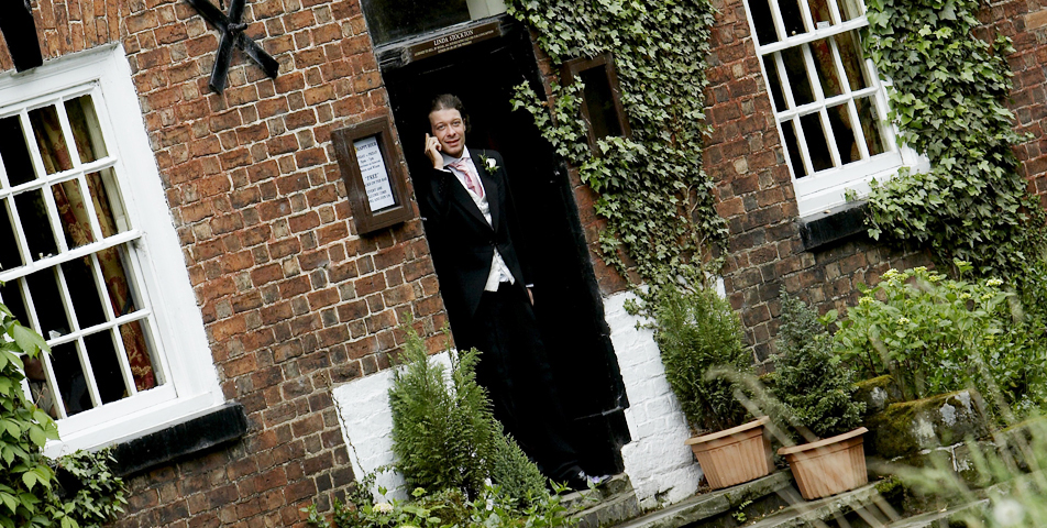 bestman enjoys a drink at the wilmslow pub before the wedding ceremony