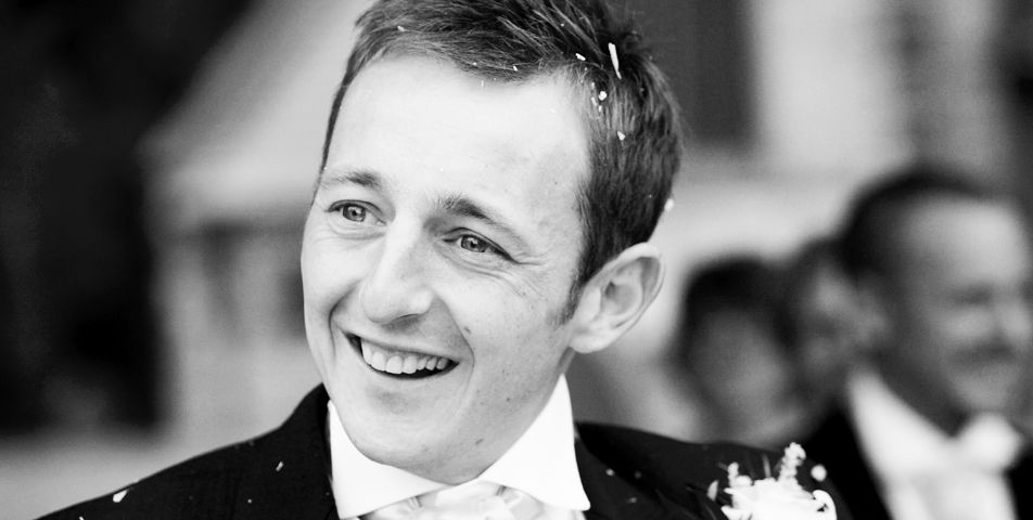 black and white wedding photography of the groom at the wedding venue The Mere Golf and Country Club