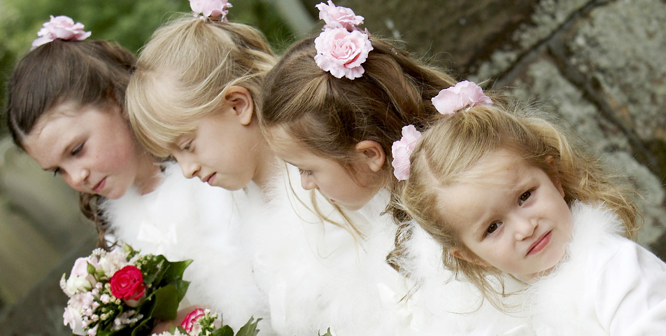 image of the bridesmaid in their beautiful dresses outside the church in Wilmslow Cheshire