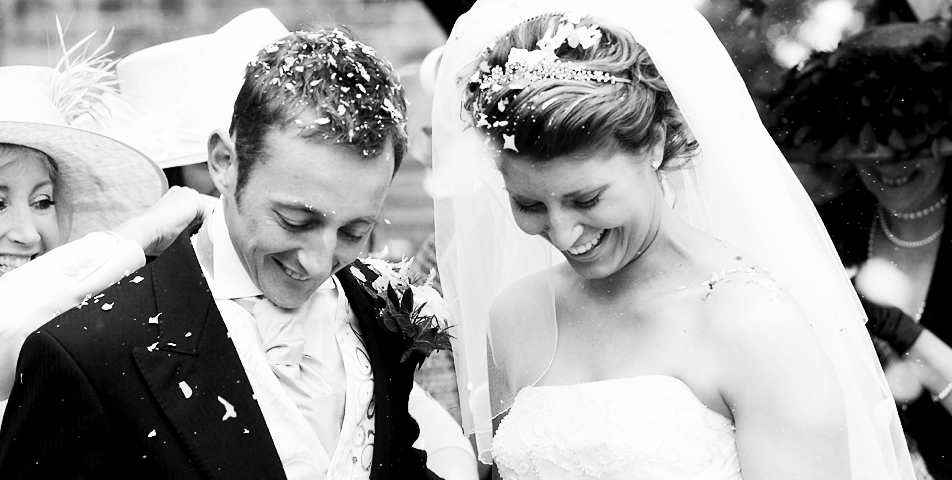 photography of the bride and groom covered in confetti