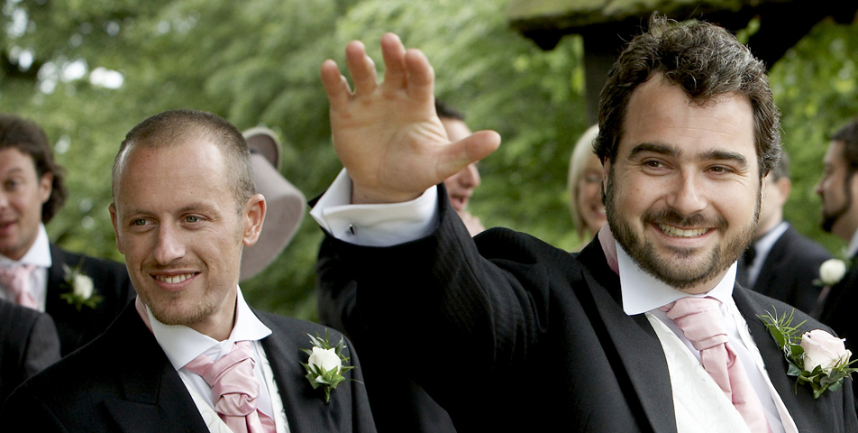the bestman going into the Church for the wedding ceremony at St Bartholomews Church Wilmslow Cheshire