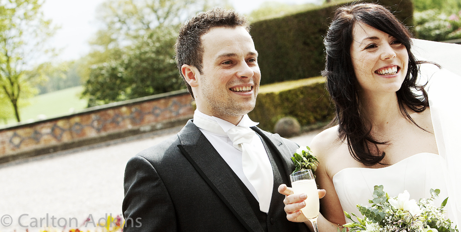 the bride and groom photographed at the wedding venue Arley hall