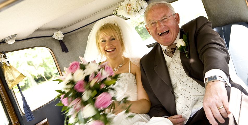 """""""wedding photography of bride in wedding car arriving at ceremony in derbyshire"""""""