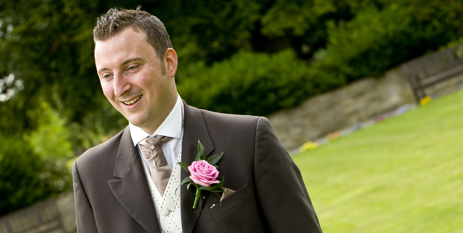 """""""Photography of the groom outside wedding venue ringwood hall hotel derbyshire"""""""