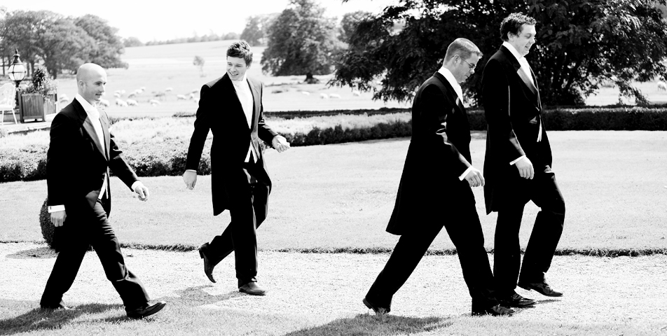 """ushers on the way captured by the wedding photographer at staplefordpark Leicestershire"""