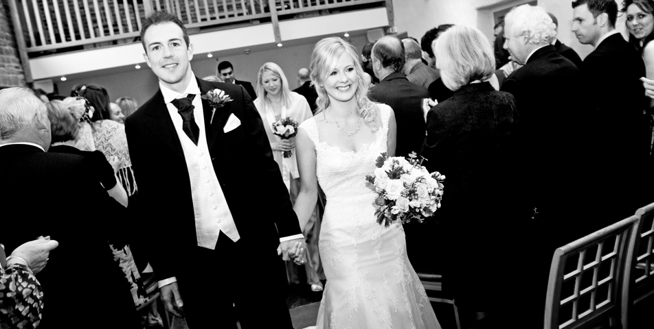 """""""wedding photography of bride and groom walking down the aisle"""""""