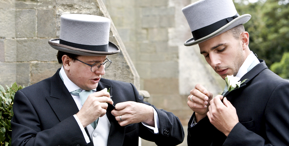 The groom and best man adjust there button holes for the wedding ceremony at yoxall village church Staffordshire