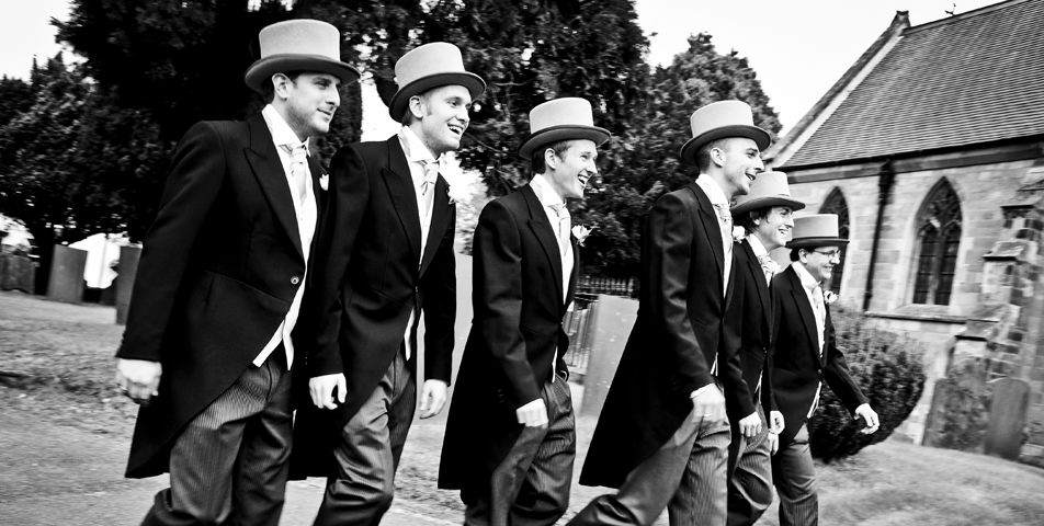 Traditional morning suits complete with top hat for the ushers and best man on the wedding day