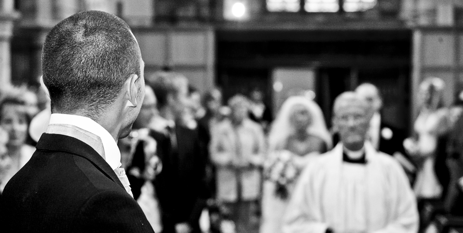 Photography of the groom seeing the bride to be for the first time walking down the aisle