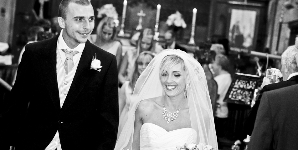 Walking down the aisle after the church wedding ceremony captured by the wedding photographer