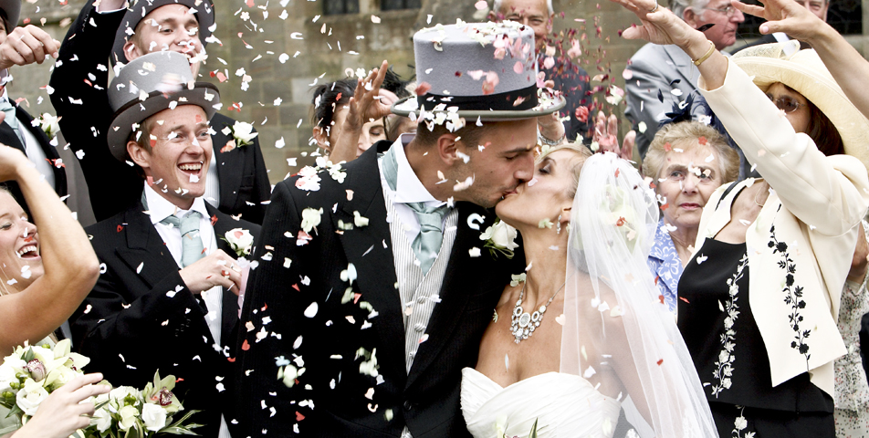 Photography of confetti thrown outside the church for the wedding celebration