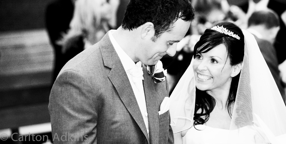 wedding photography of the bride and groom exchanging vows