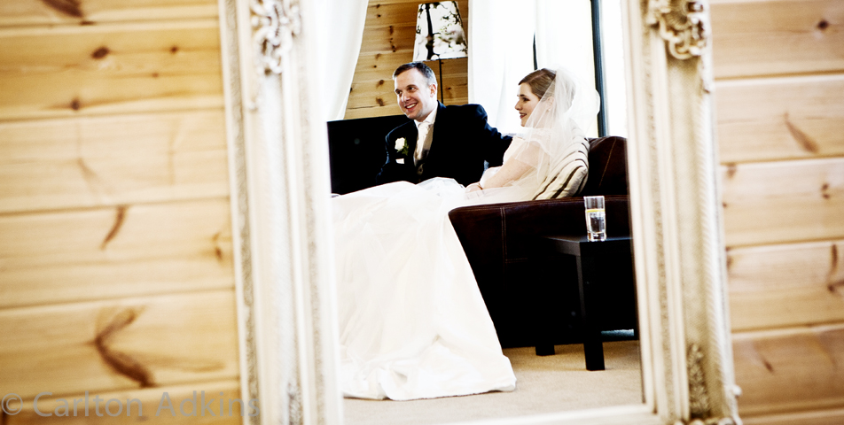 the bride and groom relax before the wedding breakfast