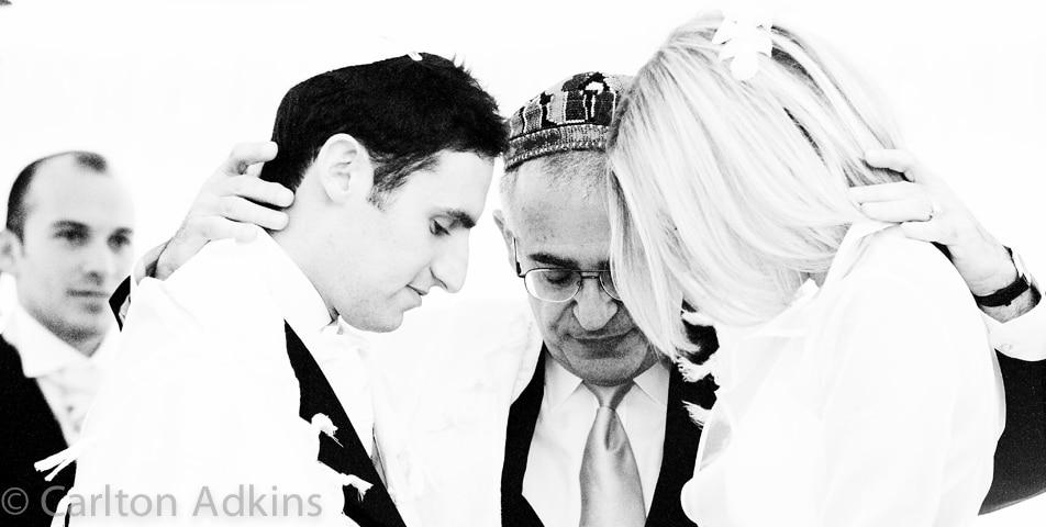 the rabbi at the jewish wedding ceremony