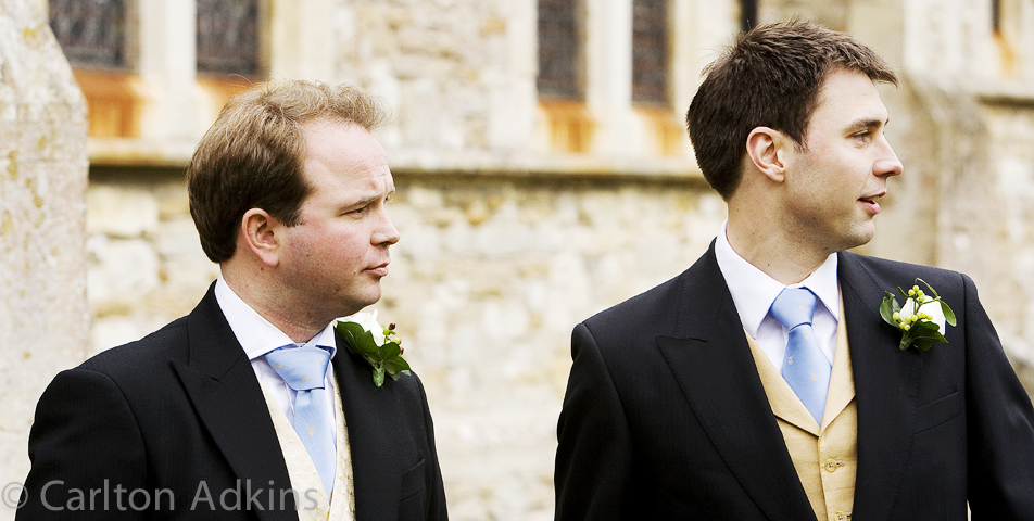 photography of the groom before the church wedding ceremony