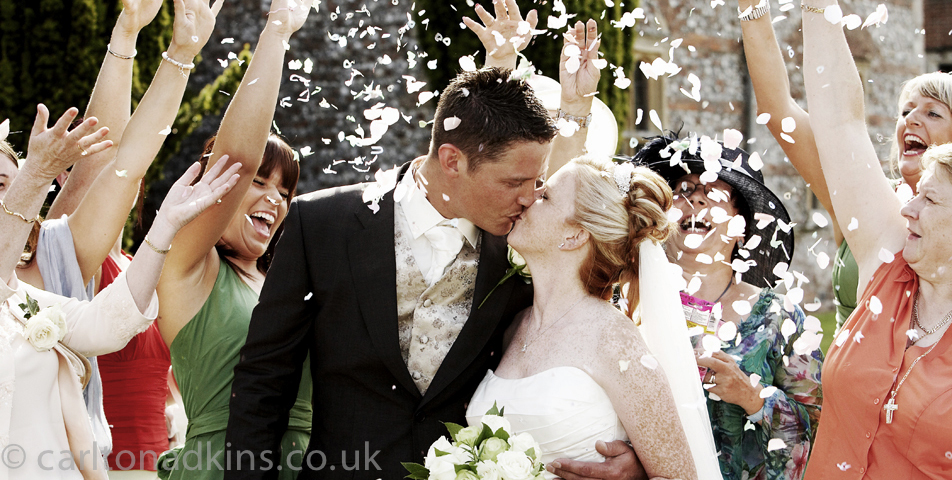 wedding photography of the confetti outside the church