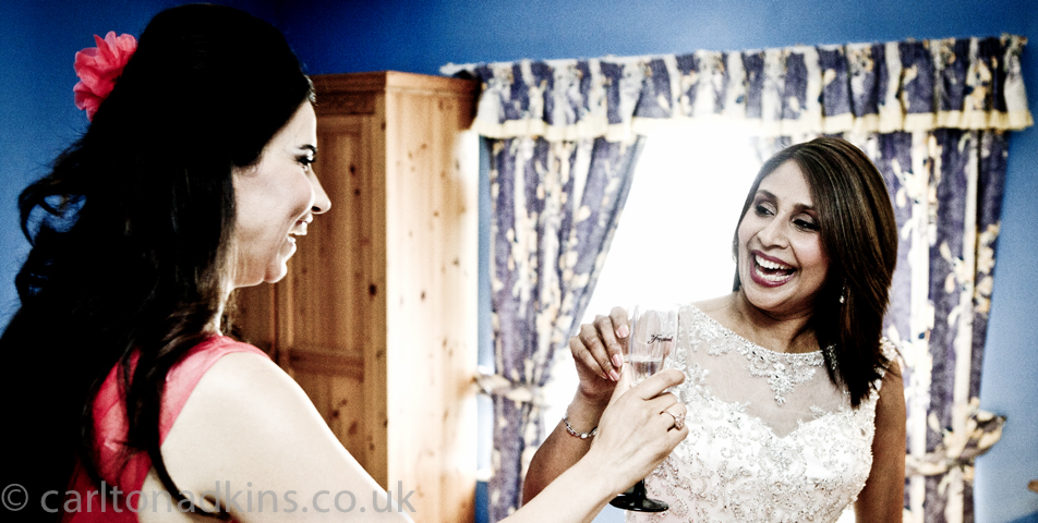 photography of the bride and bridesmaid before the wedding ceremony