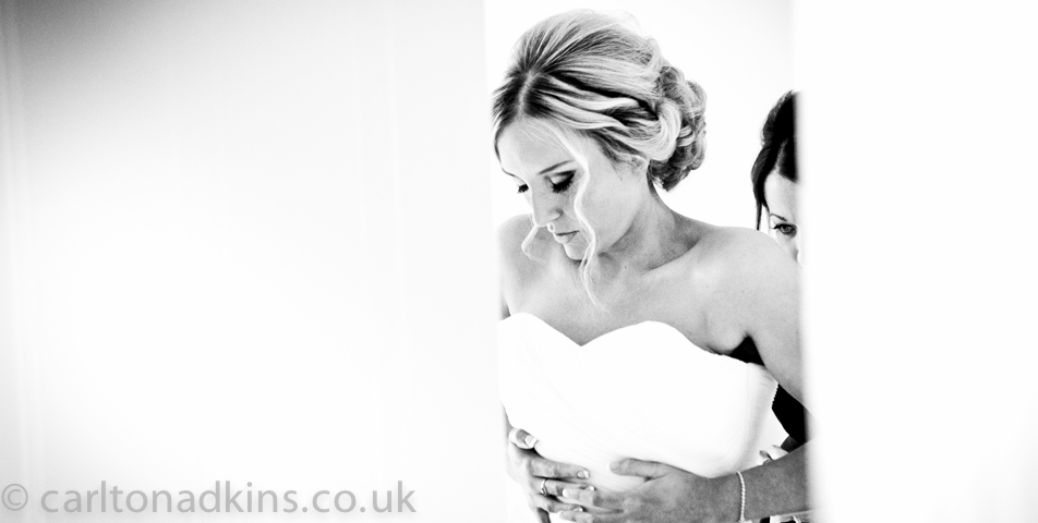 photography of the bride getting ready before the wedding ceremony in cheshire