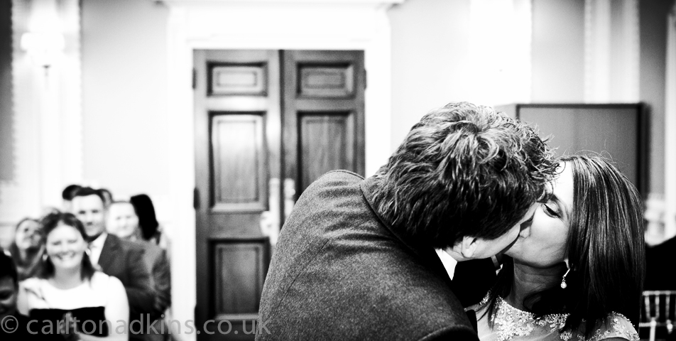 wedding photography of the bride and grooms first kiss