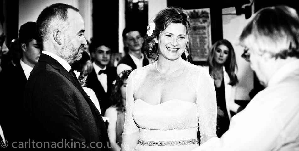 the bride and groom at the wedding ceremony in cheshire