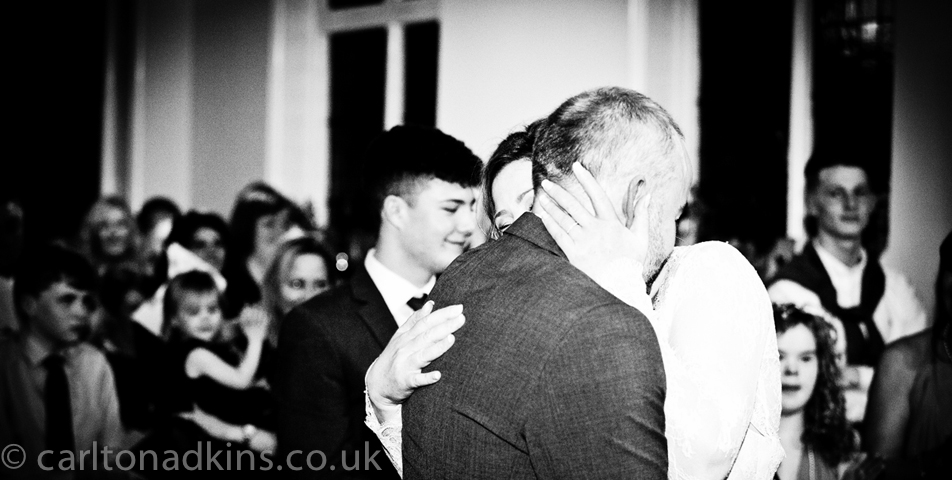 wedding photography of the first kiss at the ceremony in knutsford cheshire