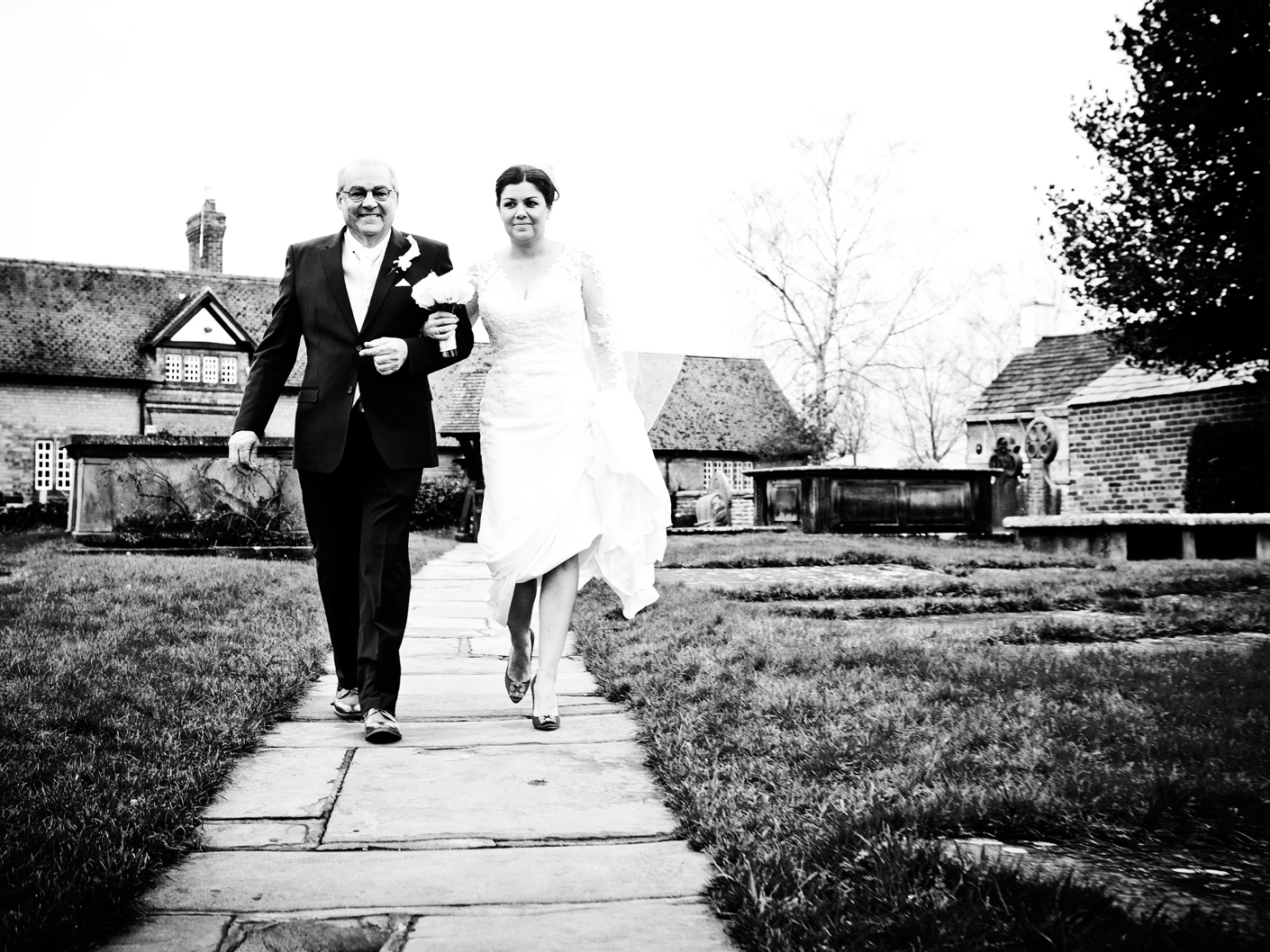 wedding-photography-of-the-father-and-bride-walking-to-the-cheshire-church