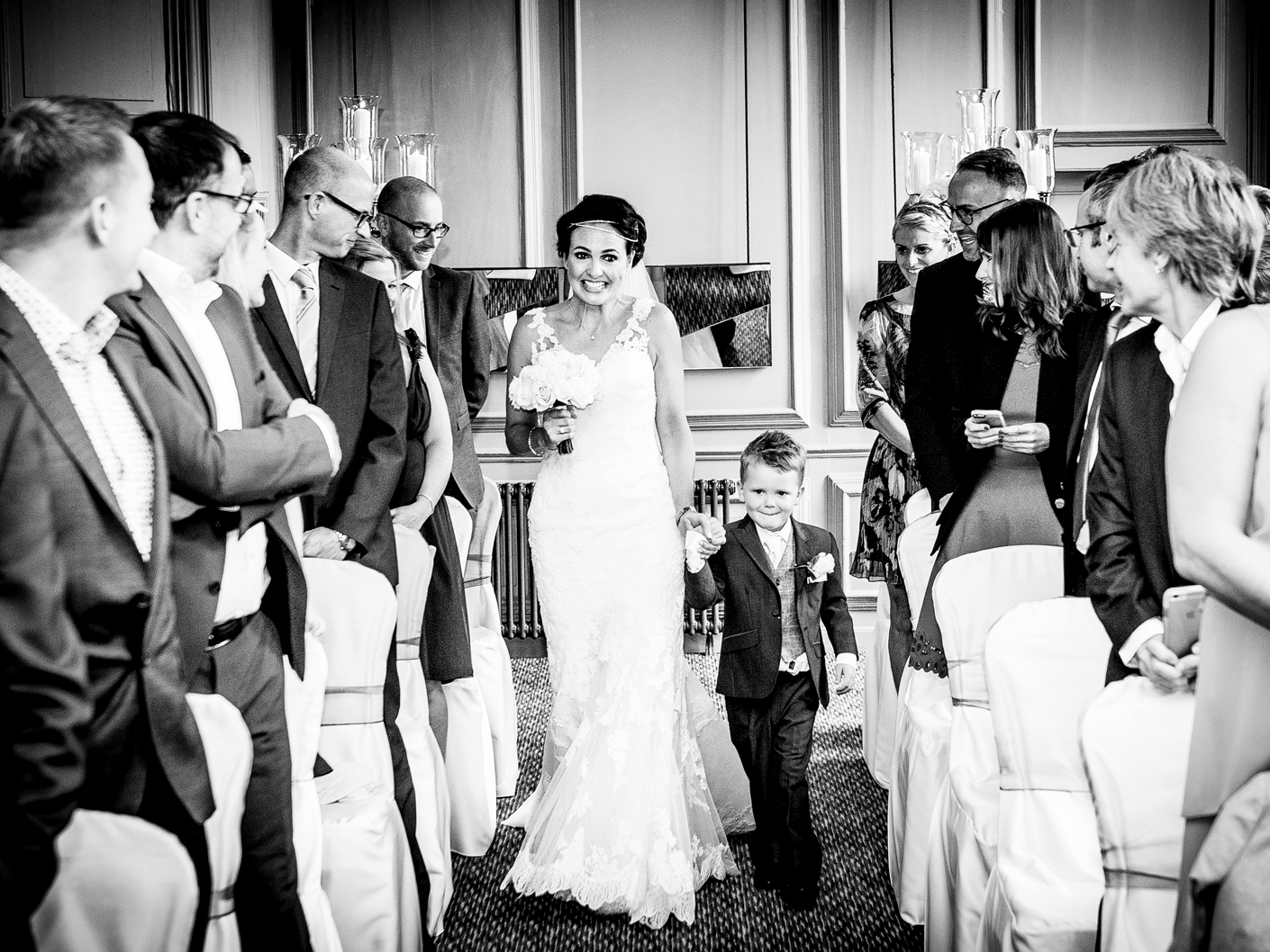 photography-of-the-bride-walking-down-the-aisle-at-the-cheshire-wedding-ceremony