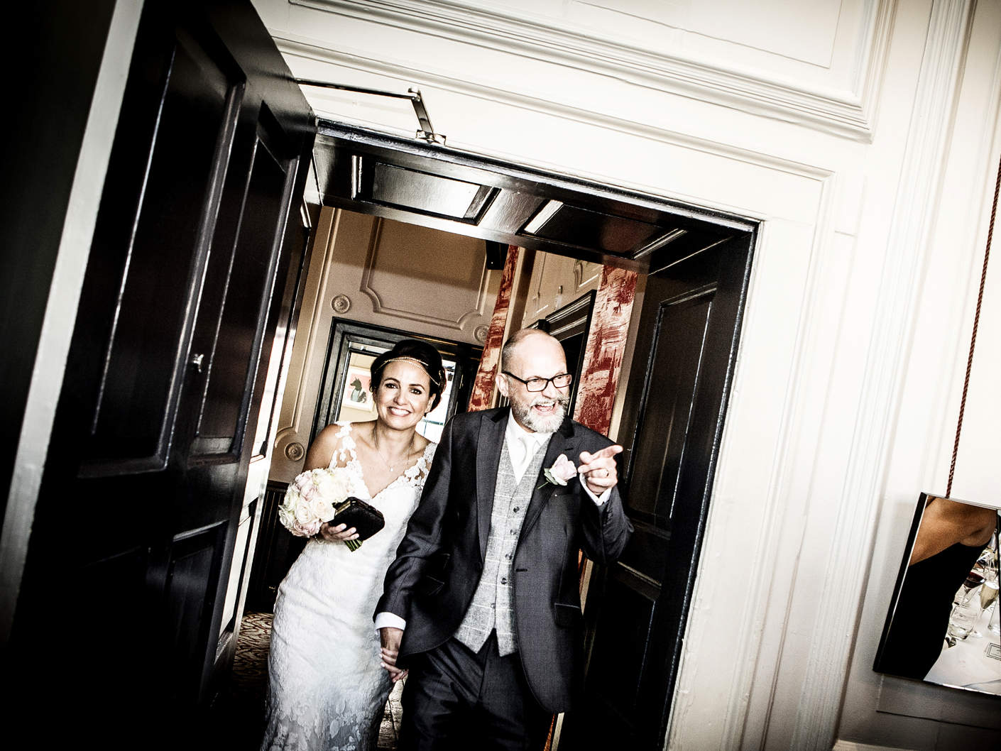 wedding-photography-of-the-bride-and-groom-entering-the-wedding-breakfast