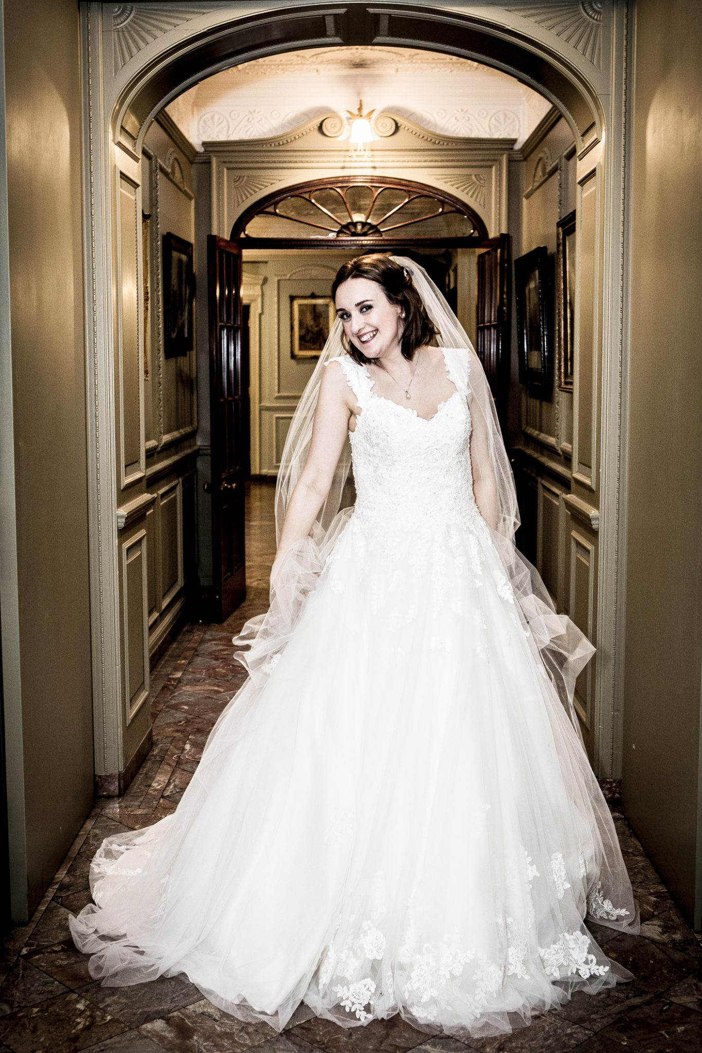 photography-of-the-bride-in-her-wedding-dress-at-thornton-manor-wirral