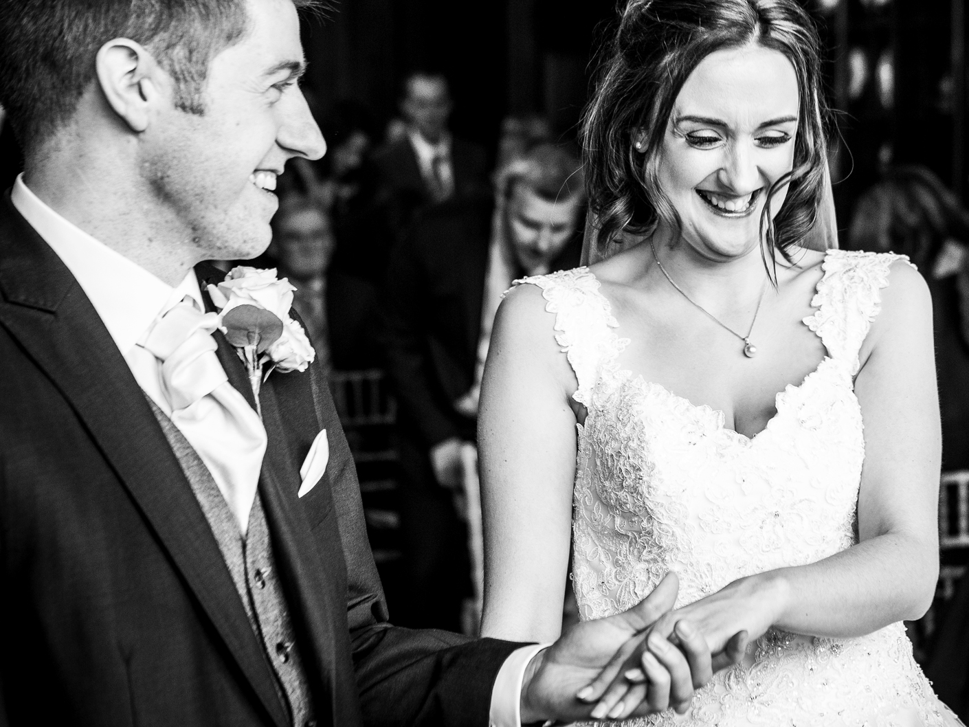 wedding-photography-of-the-exchanging-of-the-vows-in-thornton-manor