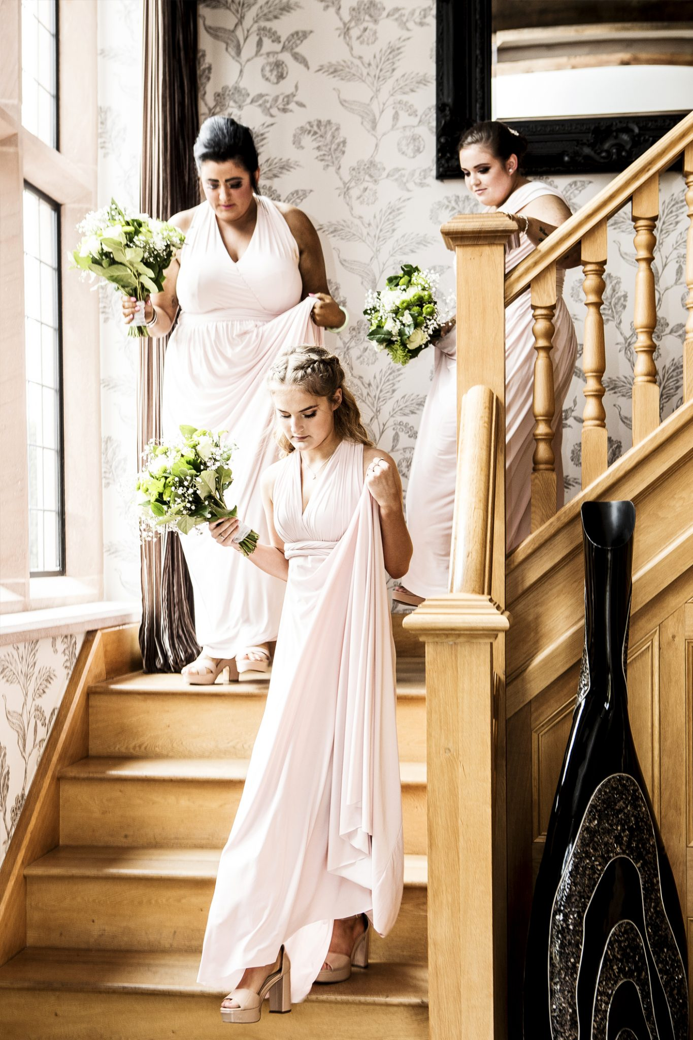 photography-of-the-bridesmaids-on-their-way-to-the-wedding-ceremony-at-merrydale-manor-knutsford-cheshire