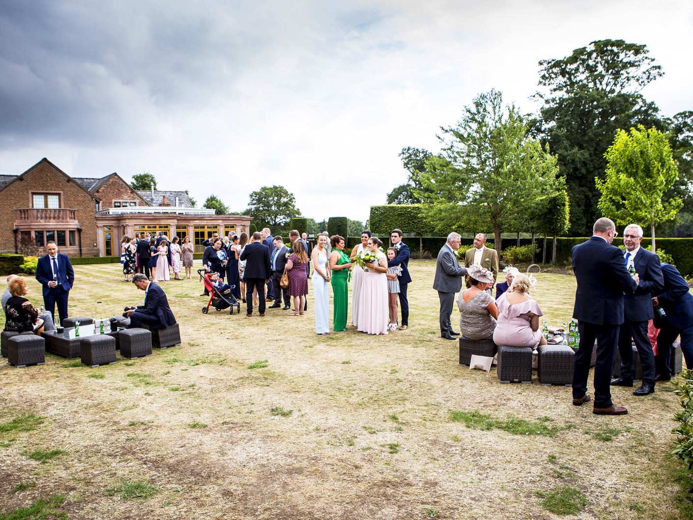 photography-of-the-wedding-party-relaxing-in-the-grounds-of-merrydale-manor-knutsford-cheshire