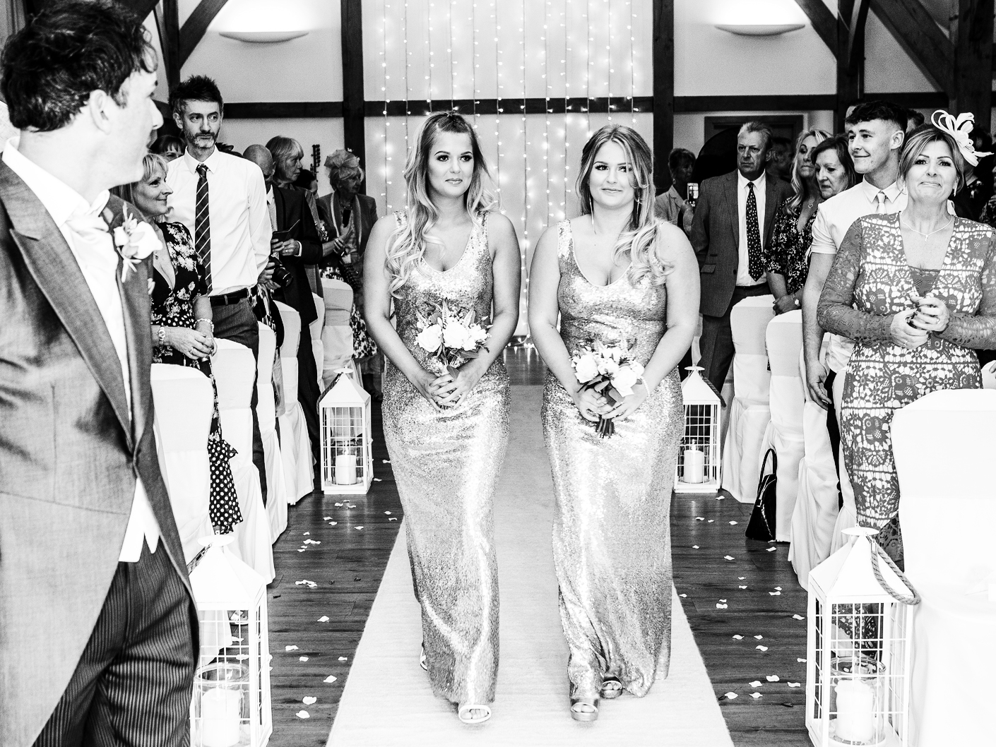 photography-of-the-bridesmaids-at-the-wedding-ceremony-at-Sandhole-Oak-Barn-Congleton-Cheshire