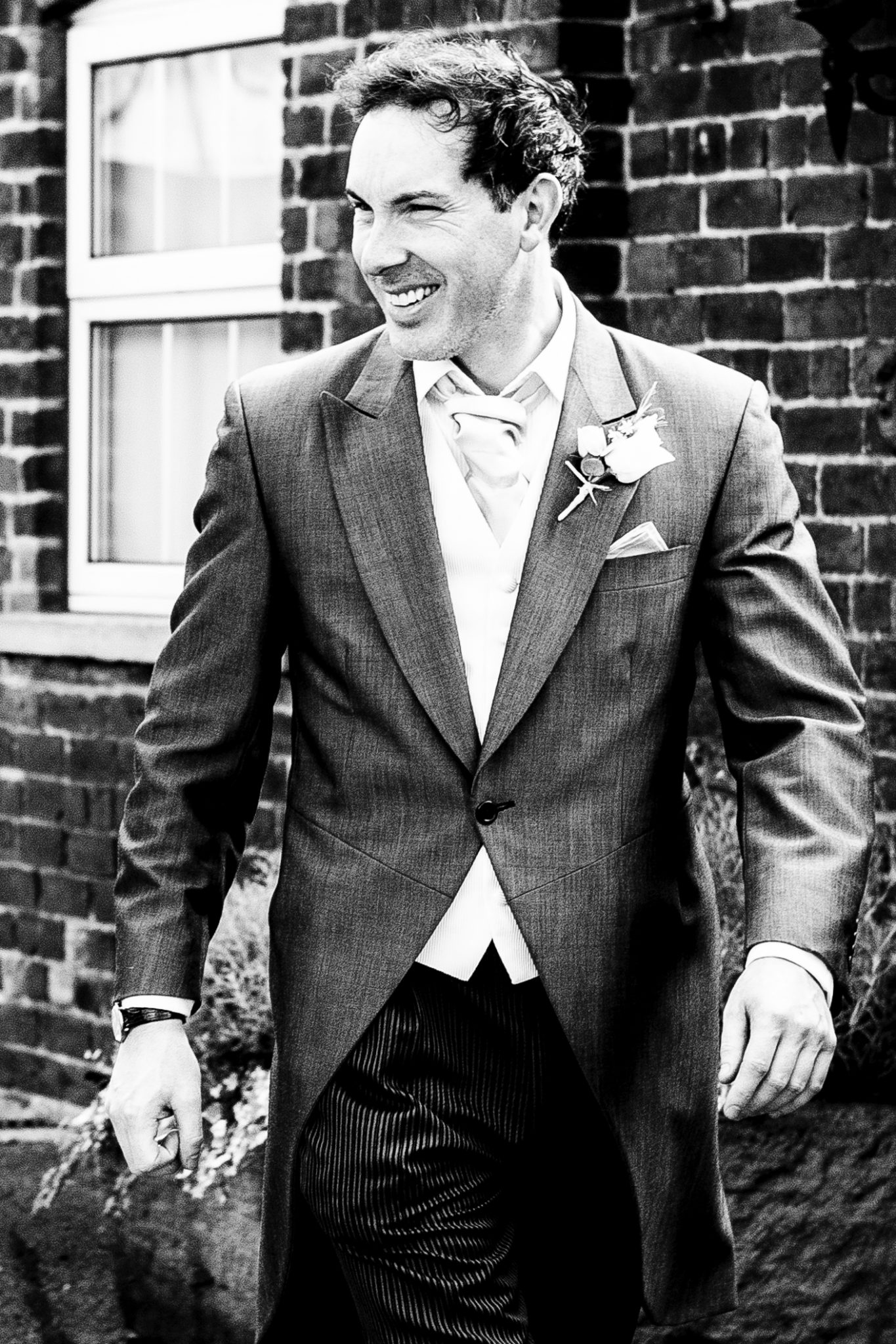 photography-of-the-groom-at-the-wedding-venue-sandhole-oak-barn-congleton-cheshire