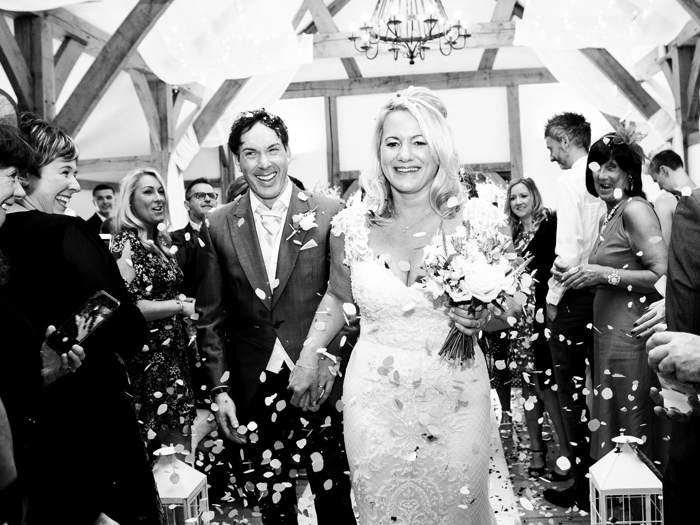 wedding-photography-of-the-bride-and-groom-with-confetti-at-sandhole-oak-barn-cheshire