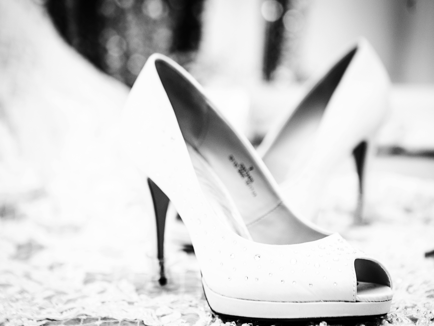 wedding-photography-of-the-brides-shoes-at-Sandhole-Oak-Barn-Congleton-Cheshire