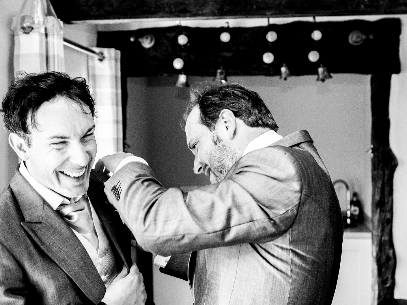 wedding-photography-of-the-groom-and-best-man-at-sandhole-oak-barn-cheshire