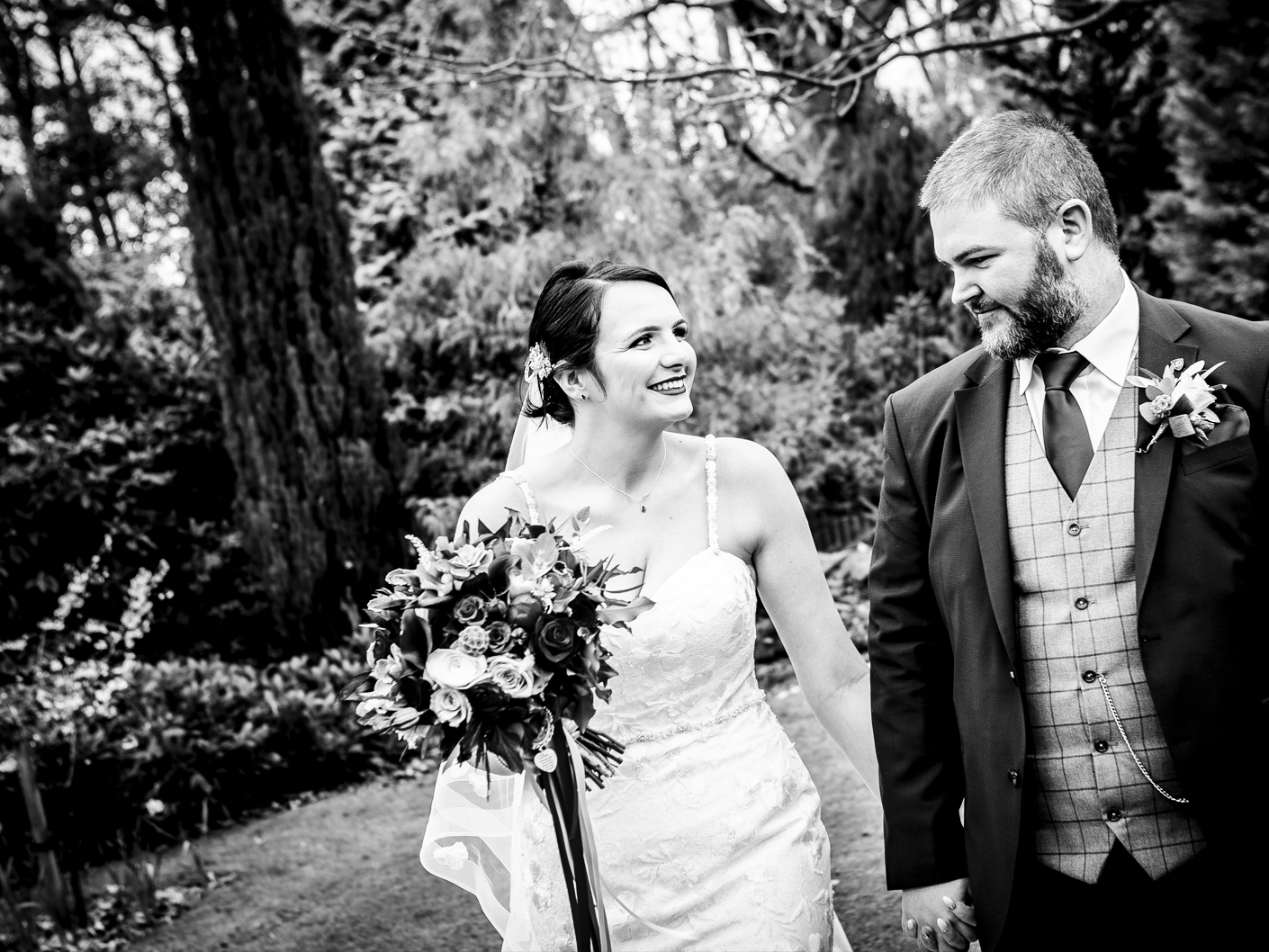 the-bride-and-groom-on-the-grounds-of-nunsmere-hall-cheshire