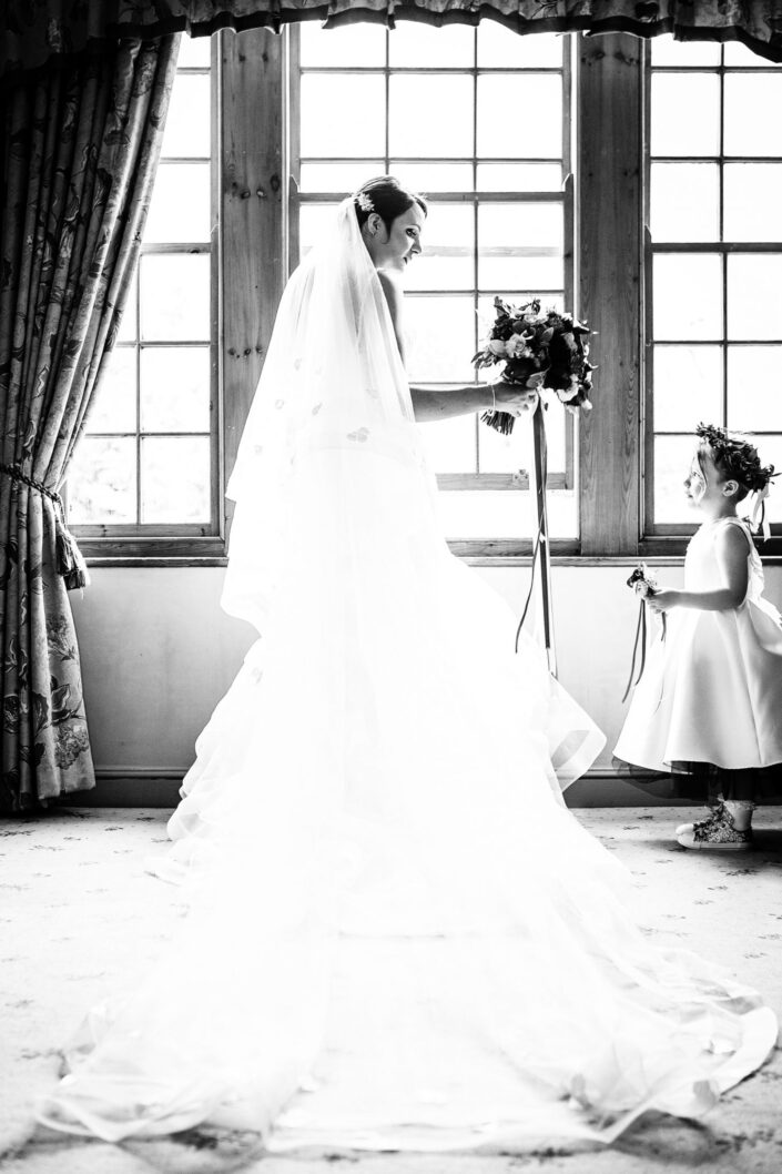 wedding-photography-of-the-bride-and-bridesmaid-at-Nunsmere-Hall-Northwich-Cheshire