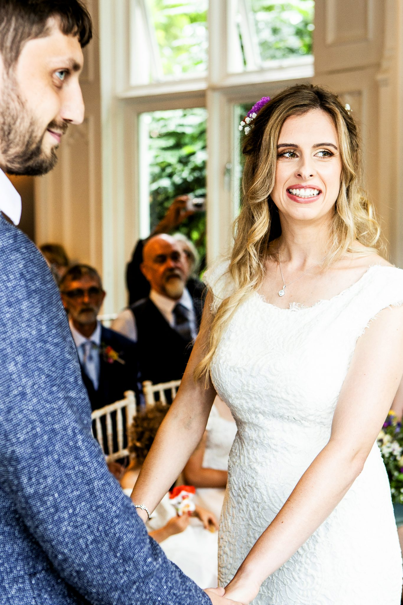 the-bride-and-groom-at-the-wedding-ceremony-in-didsbury-manchester