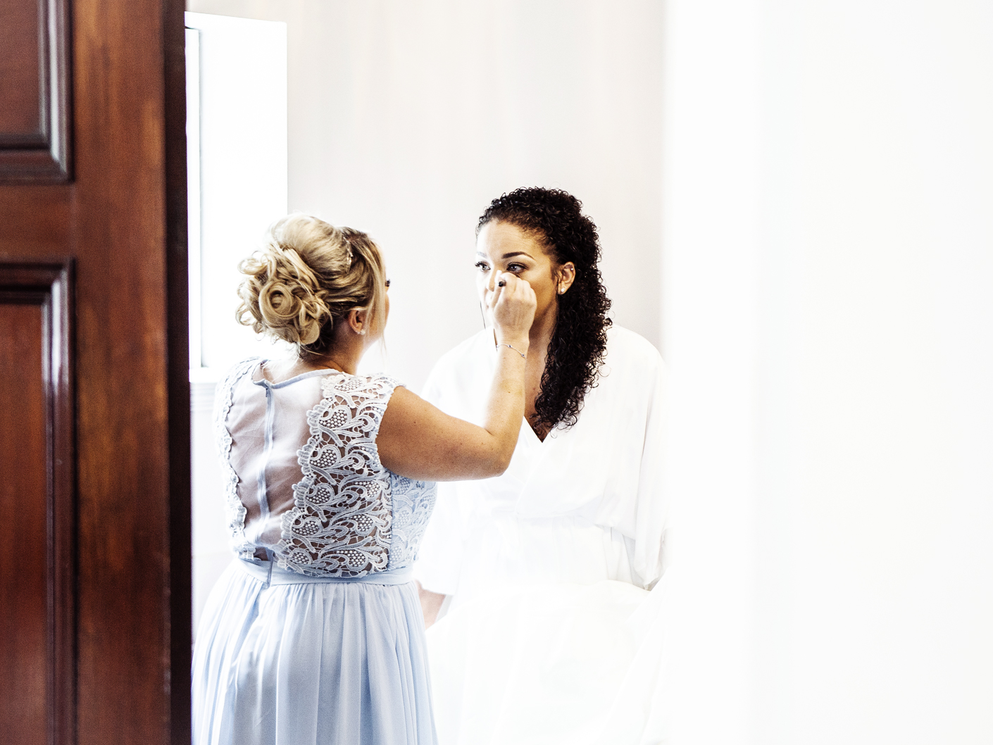 bride-and-bridesmaid-at-adlington-hall-cheshire