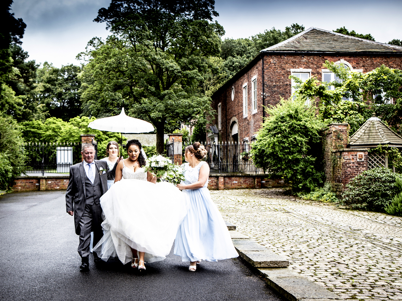 photography-of-the-bride-on-her-way-to-the-wedding-ceremony-at-adlington-hall-macclesfield-cheshire