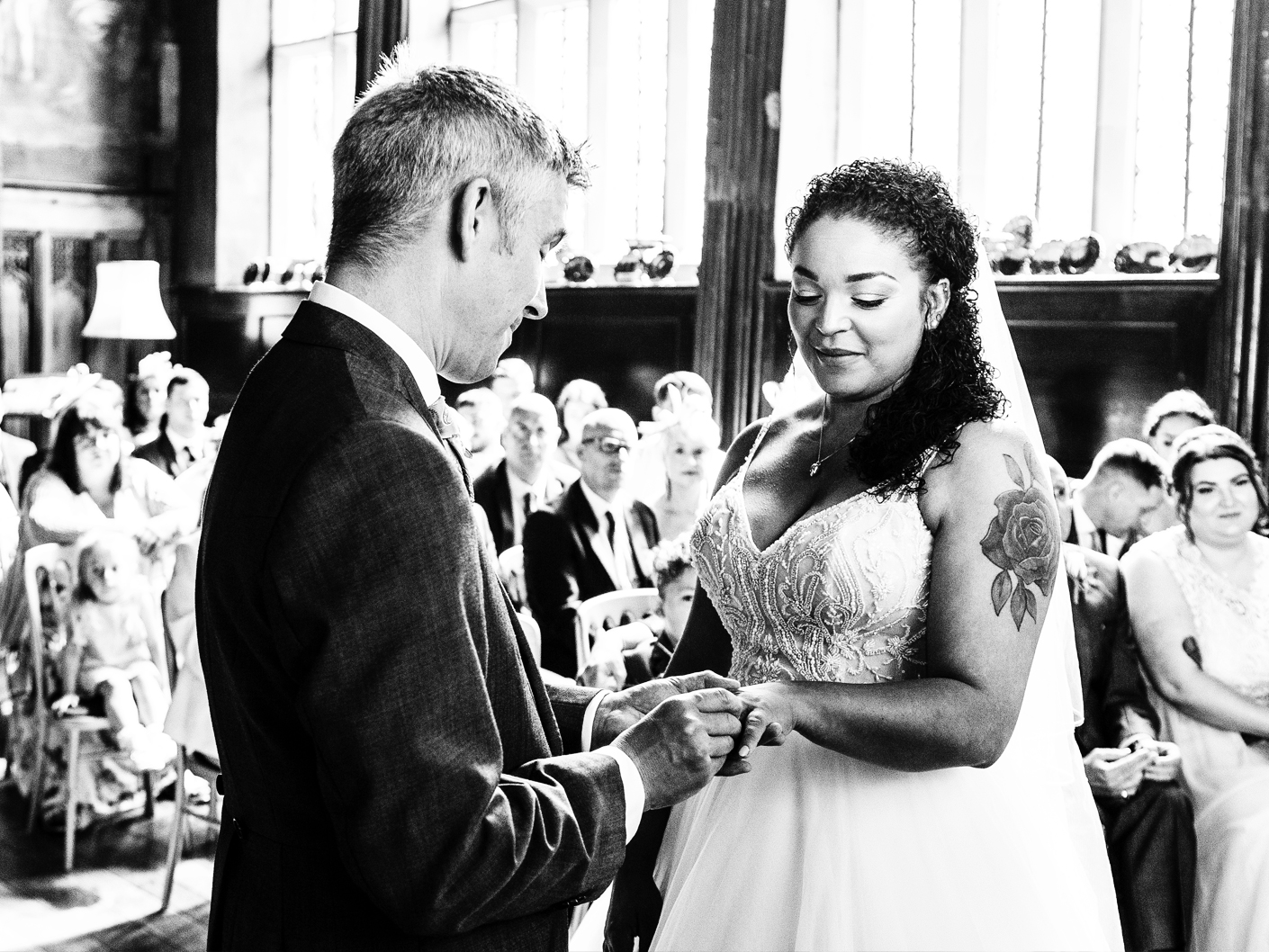 the-giving-of-the-wedding-rings-at-adlington-hall-cheshire