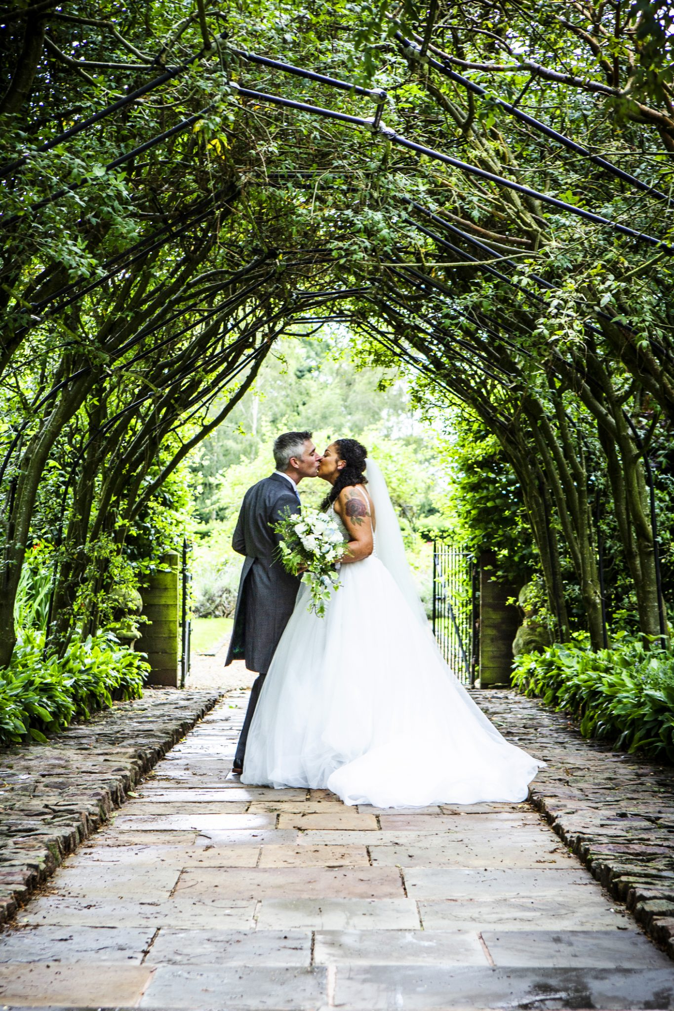 the-bride-and-groom-on-the-grounds-of-cheshire