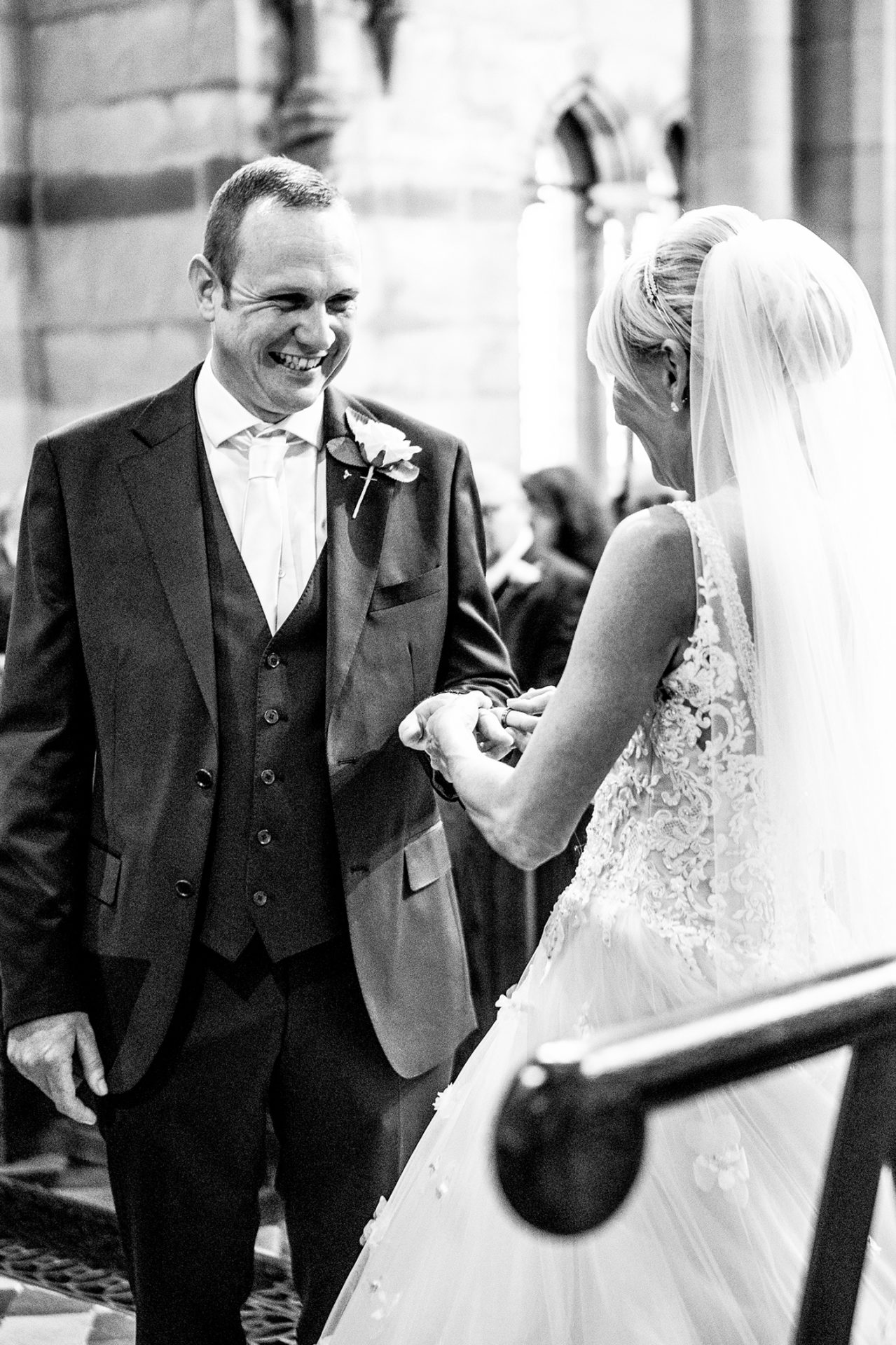 photography-of-the-exchanging-of-the-wedding-rings-in-wirral-cheshire
