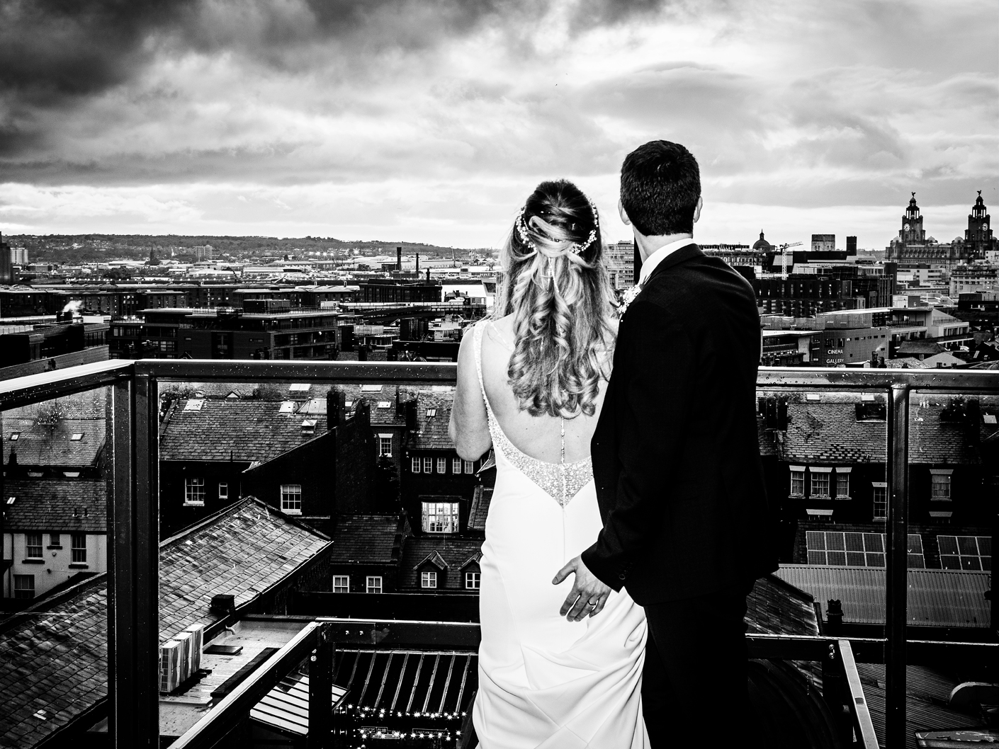 the-bride-and-groom-looking-at-the-liverpool-skyline