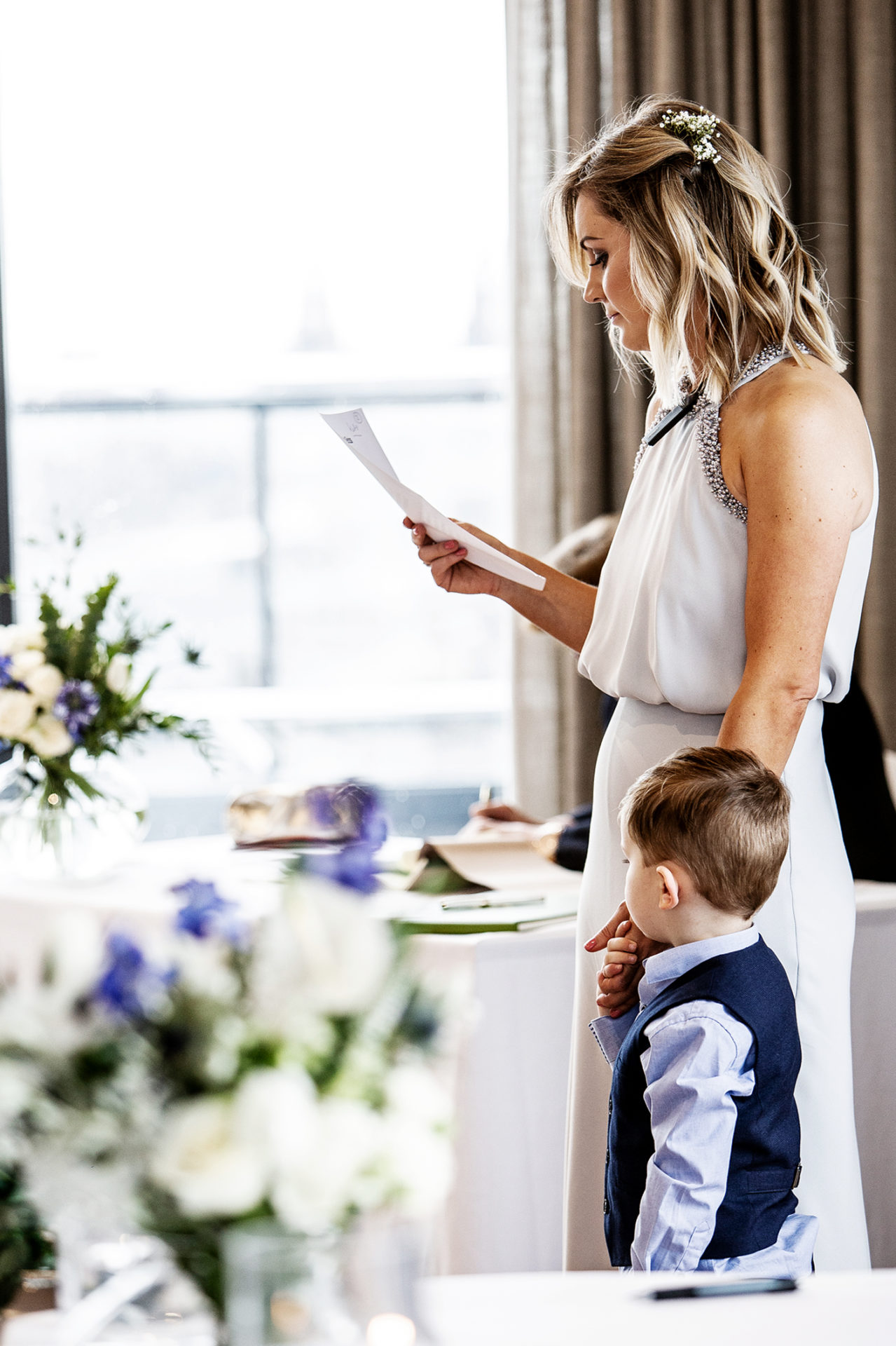 the-bridesmaid-does-a-reading-at-the-wedding-ceremony-at-hope-street-hotel-liverpool