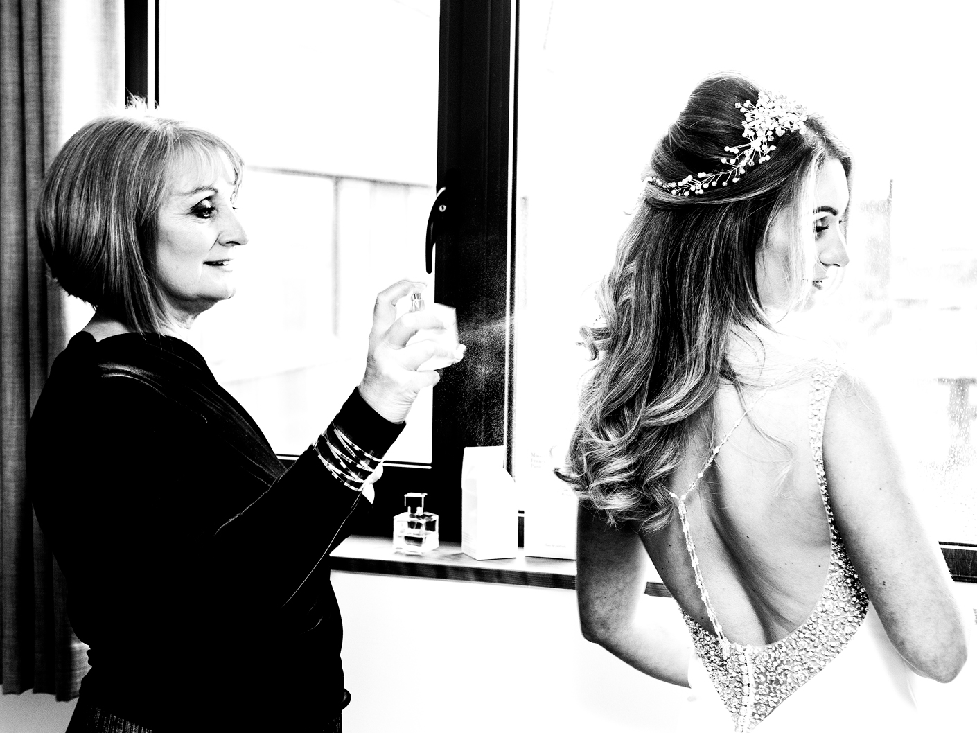the-bride-putting-on-the-wedding-dress-in-liverpool